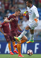 Calcio, Serie A: Roma vs Sampdoria. Roma, stadio Olimpico, 11 settembre 2016.<br /> Roma&rsquo;s Edin Dzeko, left, prepares to kick to score during the Italian Serie A football match between Roma and Sampdoria at Rome's Olympic stadium, 11 September 2016. Roma won 3-2.<br /> UPDATE IMAGES PRESS/Isabella Bonotto