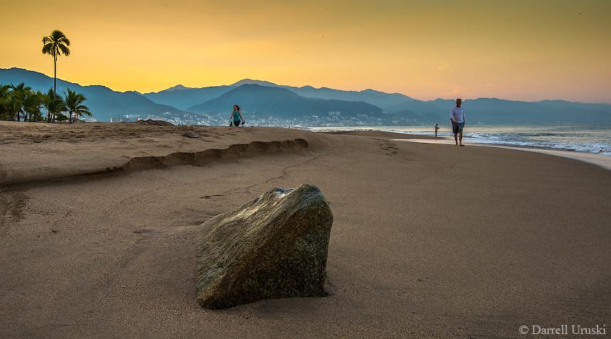 Landscape Scenic of a golden sunrise on the beaches of Puerto Vallarta, Mexico.