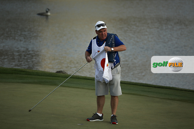 Tyrrell Hatton (ENG) caddy Michael Donaghy collecting the 18th flag pin during the final round of the Arnold Palmer Invitational presented by Mastercard, Bay Hill, Orlando, Florida, USA. 08/03/2020.<br /> Picture: Golffile | Scott Halleran<br /> <br /> <br /> All photo usage must carry mandatory copyright credit (© Golffile | Scott Halleran)