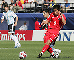 06 July 2007: North Korea's Song Chol Pak (9) plays the ball away from an Argentina defender. Argentina's Under-20 Men's National Team defeated North Korea's Under-20 Men's National Team 1-0 in a Group E opening round match at Frank Clair Stadium in Ottawa, Ontario, Canada during the FIFA U-20 World Cup Canada 2007 tournament.