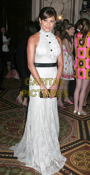 VANESSA MINNILLO.At The Breast Cancer Research Foundation's Hot Pink Party at the Waldorf Astoria, New York, NY, USA..April 24th, 2007.full length white grey gray dress sleeveless black belt buttons ruffles clutch purse bag lace.CAP/IW.©Ian Wilson/Capital Pictures