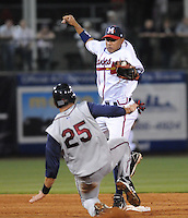9 April 2008: Diory Hernandez (7) of the Mississippi Braves tags out Cesar Nicolas (25) of Mobile BayBears during the Braves' home opener at Trustmark Park in Pearl, Miss. Photo by:  Tom Priddy/Four Seam Images