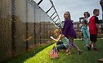 "From left, Hope Goodson, 9, Faith Goodson, 8, Tina Goodson, and Will Goodson, 10, all of Wilkesville, visit ""The Wall That Heals"", a half-scale replica of the Vietnam Veterans Memorial, in Bicentennial Park on September 15, 2017."