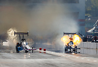 Oct 1, 2017; Madison , IL, USA; NHRA top fuel driver Shawn Langdon (right) explodes an engine alongside Steve Torrence during the Midwest Nationals at Gateway Motorsports Park. Mandatory Credit: Mark J. Rebilas-USA TODAY Sports