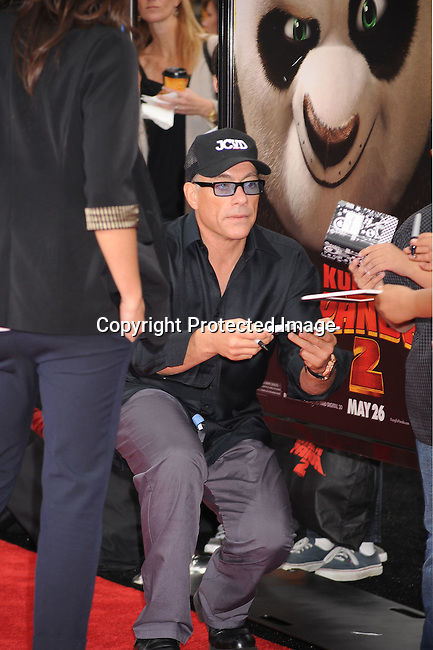 "HOLLYWOOD, {CA} -MAY 22: Jean-Claude Van Damme and family arrive at the Los Angeles premiere of ""Kung Fu Panda 2"" held at Grauman's Chinese Theatre on May 22, 2011 in Hollywood, California."