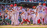 25 July 2013: Washington Nationals outfielder Bryce Harper comes home to score after hitting his first career walk-off home run in the bottom of the 9th inning to break a 7-7 tie and defeat the Pittsburgh Pirates 9-7 at Nationals Park in Washington, DC. The Nationals salvaged the last game of their series to end their 6-game losing streak. Mandatory Credit: Ed Wolfstein Photo *** RAW (NEF) Image File Available ***