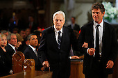 Boston, MA - August 29, 2009 -- Senator Edward Kennedy's brother in law Sargent Shriver is escorted to his seat in the church by his son Anthony Kennedy Shriver (R) as U.S. President Barack Obama (3rd L), former President George W. Bush (2nd L) and Secretary of State Hillary Clinton (L) look on. during funeral services for U.S. Senator Edward Kennedy at the Basilica of Our Lady of  Perpetual Help in Boston, Massachusetts August 29, 2009.  Senator Kennedy died late Tuesday after a battle with cancer. .Credit: Brian Snyder- Pool via CNP