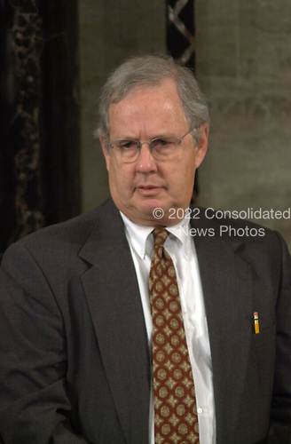 Charles Johnson, Parliamentarian, United States House of Representatives, watches the counting of the electorial votes in the U.S. House Chamber in Washington, D.C. on January 6, 2001.  The Parliamentarian is one of the Officials of the U.S. House elected by the members.  Mr. Johnson advised Vice President Al Gore in the proceedures of the vote count and the limiting of debate during the Joint Session. .Credit: Ron Sachs / CNP
