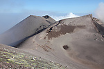 Summit region of Mount Etna volcano, Sicily, Italy. View from North Crater with sulfur deposits on flank. Voragine and Bocca Nuova Craters on right and conical Southeast Crater on left.