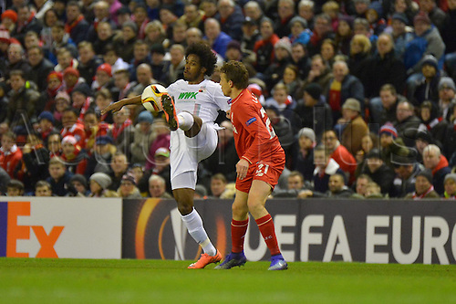 25.02.2016. Liverpool, England. UEFA Europa League game between Liverpool FC and Augsburg.  CAIUBY (FC Augsburg)challenges Lucas Leiva (FC Liverpool)