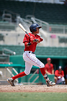 GCL Red Sox second baseman Ricardo Cubillan (20) follows through on a swing during a game against the GCL Orioles on August 9, 2018 at JetBlue Park in Fort Myers, Florida.  GCL Red Sox defeated GCL Orioles 10-4.  (Mike Janes/Four Seam Images)