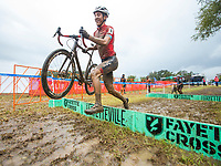 NWA Democrat-Gazette/BEN GOFF @NWABENGOFF<br /> Jared Scott of the Boulder Junior Cycling team smiles as he crosses a barrier on the last lap of the UCI Junior Men race Sunday, Oct. 6, 2019, during the the Fayettecross cyclocross races at Centennial Park at Millsap Mountain in Fayetteville. Scott was the winner of the race.