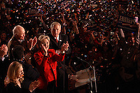Democratic presidential candidate Hillary Clinton (in red), flanked by (L-R) daughter Chelsea Clinton, Rep. Stephanie Tubbs-Jones (D-OH), former senator John Glenn (D-OH), and Ohio governor Ted Strickland, celebrates her victory during a primary election night rally, March 4, 2008, at the Columbus Atheneum, Columbus, Ohio. On this night, Clinton defeated rival Barack Obama to win primaries in Ohio, Texas, and Rhode Island, while Obama won in Vermont. (Kevin Craiglow/PressPhotoIntl.com)