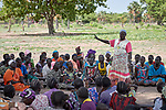 Debora Ding, a community worker, talks with local villagers at a community meeting about health on the grounds of the Loreto School outside Rumbek, South Sudan. The school is run by the Institute for the Blessed Virgin Mary--the Loreto Sisters--of Ireland.