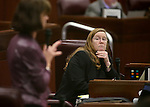 Nevada Assemblywoman Maggie Carlton, D-Las Vegas, listens to Assemblywoman Robin Titus, R-Wellington, during Assembly floor discussion at the Legislative Building in Carson City, Nev., on Monday, April 6, 2015. <br /> Photo by Cathleen Allison