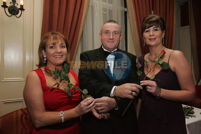 Drogheda Olympic Committee Presents Tony Sox Byrne Gala Dinner in the West Court Hotel. Pictured Teresa Leech and Rita Maguire are presented with Roses..Photo: Fran Caffrey/ Newsfile.<br />