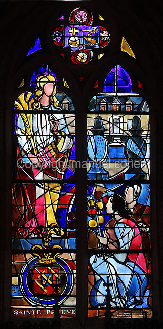 Stained glass window of Sainte-Preuve castle, with its owner the Princess of Caraman Chimay giving flowers to a missionary Virgin, 1975, in a chapel in the Basilica of Liesse Notre Dame, built 1134 in Flamboyant Gothic style by the Chevaliers d'Eppes, then rebuilt in 1384 and enlarged in 1480 and again in the 19th century, Liesse-Notre-Dame, Laon, Picardy, France. Pilgrims flock here to worship the Black Virgin, based on Ismeria, the Soudanese daughter of the sultan of Cairo El-Afdhal, who saved the lives of French knights during the Crusades, converted to christianity and married Robert d'Eppes, son of Guillaume II of France. Picture by Manuel Cohen