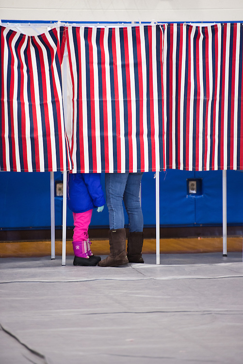 UNITED STATES - February 9: Voters fill out their ballots for the 2016 New Hampshire primary in voting booths at Londonderry High School in Londonderry, NH on February 9, 2016. (Meredith Dake-O'Connor/CQ Roll Call)