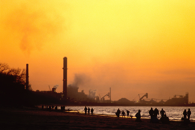 A steel mill dominates the Lake Michigan shore at sunset from Indiana Dunes National Lakeshore, Indiana