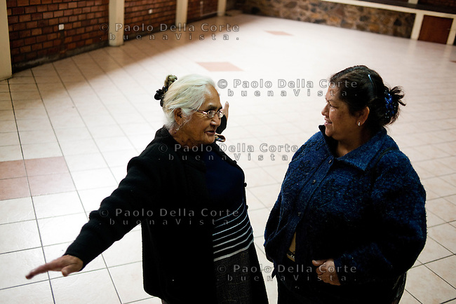 Villa Maria del Triunfo (Lima) - Uberdina Ortega(left), 80 years old, is the District President of ComedoresPopulares de Villa María delTriunfo. In 1958 she founded the Club de Madres de Villa Maria and opened the first community kitchen there. Now there are 188 comedores in Villa María delTriunfo.
