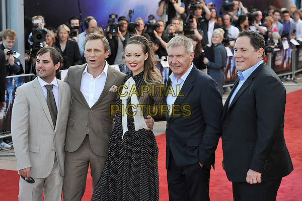 Roberto Orci, Daniel Craig, Olivia WIlde, Harrison Ford & Jon Favreau .UK Premiere of 'Cowboys and Aliens' at the Cineworld cinema at the O2 Arena, London, England..August 11th 2011.half 3/4 length black white pussybow sheer polka dot dress side panel hairband blue beige suit shirt .CAP/MAR.© Martin Harris/Capital Pictures.