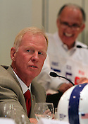 NCSU coach Tom O'Brien faces some uncertainty this season as Mike Glennon steps in for the departed Russell Wilson. However at the 9th annual Bill Dooley Pigskin Preview, he jokes with the other coaches as Don Shea is all smiles behind him. Photo by Al Drago.
