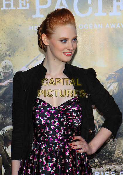 "DEBORAH ANN WOLL .Attending the Los Angeles Premiere of HBO's ""The Pacific"" held at Grauman's Chinese Theater, Hollywood, California, USA, 24th February 2010 .half length black jacket pink purple print patterned pattern dress hand on hip .CAP/ADM/TC.©T. Conrad/AdMedia/Capital Pictures."