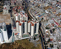 aerial photograph of the Palmas Doral tower, Interlomas, Mexico City, adjacent to poor residential dwellings