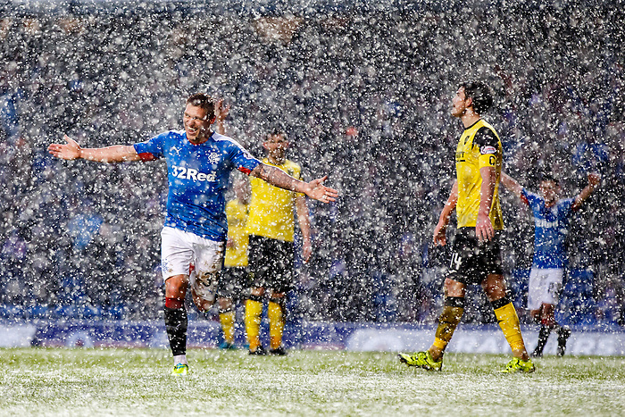 Martyn Waghorn celebrates goal no 4 in a snowstorn