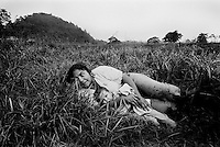 colombia1068 - civilians are caught in the crossfire between government troops and FARC guerrillas, near Puerto Rico, soon after 3 years of peace talks came to a sudden end. Caqueta march 2002<br />