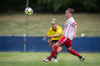 Victoria Wotton of Watford Ladies clears from Amy Josland of Stevenage Ladies during the pre season friendly match between Stevenage Ladies FC and Watford Ladies at The County Ground, Letchworth Garden City, England on 16 July 2017. Photo by Andy Rowland / PRiME Media Images.