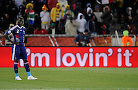 A dejected Bakari Sagna of France stands with hands on hips after the second Mexico goal
