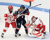 Kasey Boucher (BU - 3), Rachel Farrel (UConn - 8), Braly Hiller (BU - 31) - The Boston University Terriers defeated the visiting University of Connecticut Huskies 4-2 on Saturday, November 19, 2011, at Walter Brown Arena in Boston, Massachusetts.