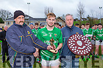 Morgan O'Sullivan and Mike Sayers presents milltown/Castlemaine captain David Roche the Man of the Match award after they defeated Laune Rangers in the Mid Kerry minor final in Beaufort on Sunday