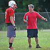 East Islip assistant coach Joe Taormina, right, talks to one of his players during football team practice at the high school on Wednesday, August 19, 2015.
