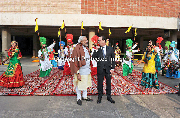 24.01.2016; Chandigarh, India: PRESIDENT HOLLANDE AND INDIAN PM MODI<br /> being welcomed with traditional dances at Government Museum &amp; Art Gallery, in Chandigarh.<br /> The French President in the guest of honour for the Republic Day celebrations on the 26th of January 2016.<br /> Mandatory Credit Photos: &copy;NEWSPIX INTERNATIONAL<br /> <br /> PHOTO CREDIT MANDATORY!!: NEWSPIX INTERNATIONAL(Failure to credit will incur a surcharge of 100% of reproduction fees)<br /> <br /> IMMEDIATE CONFIRMATION OF USAGE REQUIRED:<br /> Newspix International, 31 Chinnery Hill, Bishop's Stortford, ENGLAND CM23 3PS<br /> Tel:+441279 324672  ; Fax: +441279656877<br /> &quot;All fees payable to &quot;Newspix International&quot;<br /> e-mail: info@newspixinternational.co.uk