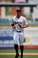 Birmingham Barons left fielder Eloy Jimenez (21) jogs off the field during a game against the Pensacola Blue Wahoos on May 9, 2018 at Regions FIeld in Birmingham, Alabama.  Birmingham defeated Pensacola 16-3.  (Mike Janes/Four Seam Images)