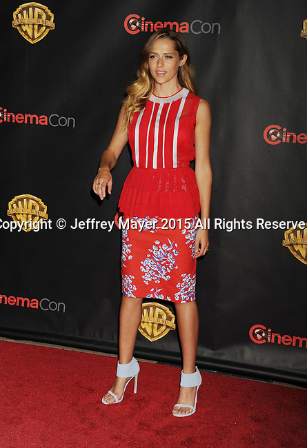 LAS VEGAS, CA - APRIL 21: Actress Teresa Palmer arrives at Warner Bros. Pictures Invites You to ?The Big Picture at The Colosseum at Caesars Palace during CinemaCon, the official convention of the National Association of Theatre Owners, on April 21, 2015 in Las Vegas, Nevada.