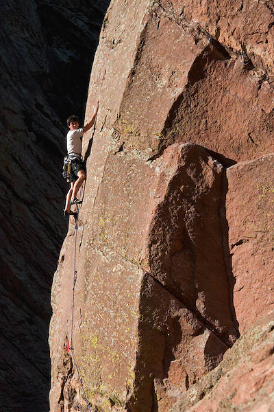 Caucasian male leading the West Buttress Route on the Bastille rock formation in Eldorado Canyon, Boulder, Colorado. .  John leads private photo tours in Boulder and throughout Colorado. Year-round.