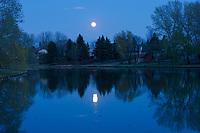 Moon rising over pond. Southdale neighbourhood. <br />Winnipeg<br />Manitoba<br />Canada