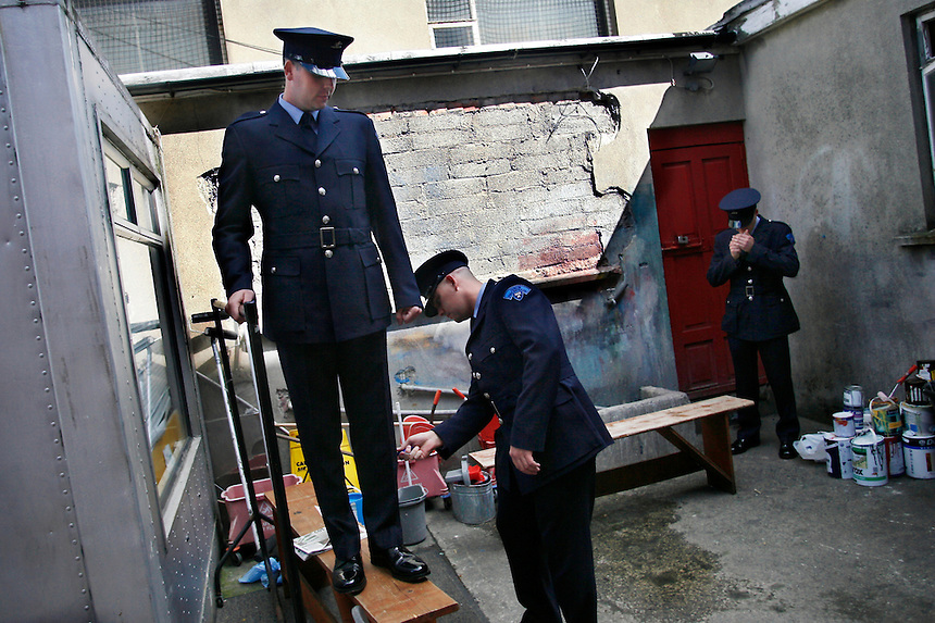 """Dublin Fire Brigade recruits prepare for their """"Passing-Out Parade"""" at the Dublin Fire Brigade Training Centre, by cleaning the uniforms and grabbing a quick cigarette. The 34 recruits just finished a 24 week training program, and will be rotated into various stations throughout the city."""