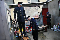"Dublin Fire Brigade recruits prepare for their ""Passing-Out Parade"" at the Dublin Fire Brigade Training Centre, by cleaning the uniforms and grabbing a quick cigarette. The 34 recruits just finished a 24 week training program, and will be rotated into various stations throughout the city."