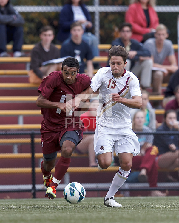 Harvard University midfielder Andrew Wheeler-Omiunu (18) and Boston College midfielder Giuliano Frano (15) battle for the ball. Boston College (white) defeated Harvard University (crimson), 3-2, at Newton Campus Field, on October 22, 2013.