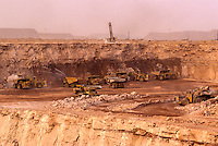 Arlit, Niger.  Heavy earth movers  excavating open-pit uranium mine.
