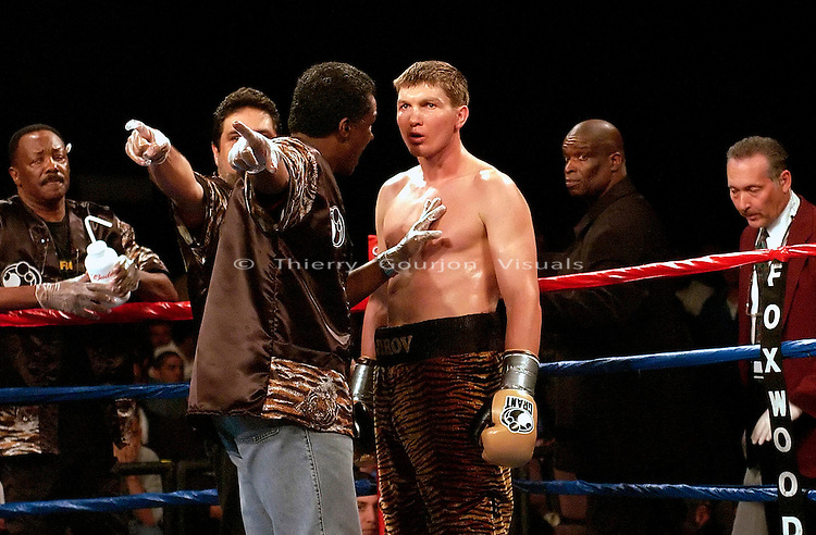 Vassiliy Jirov (R), being motivated by trainer Tommy Brooks before his IBF Cruiserweight Championship Fight against James Toney at the Foxwoods Casino in Mashantucket, Connecticut on April 26, 2003. James Toney won the fight by Unanimous decision.