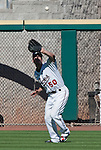 Reno Aces Brent Clevlen fights the sun to make the catch against the Sacramento River Cats during their play off game played on Sunday afternoon, September 9, 2012 in Reno, Nevada.