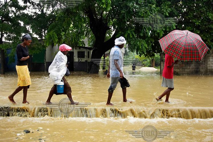 People walk through flood waters during Hurricane Gustav.