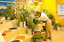 Hostes waters a plant at Urban garden in Germany pavilion at Expo 2015, Rho-Pero, Milan, July 2015. &copy; Carlo Cerchioli <br /> <br /> Hostes innaffia una pianta del Giardino urbano nel padigione della Germania a Expo 2015, Rho-Pero, Milano, luglio 2015.