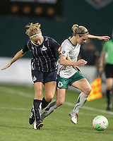 Lene Mykjvelan #7 of the Washington Freedom tackles Lindsay Tarpley #5 of St. Louis Athletica during a WPS match on May 1 2010, at RFK Stadium, in Washington D.C. Freedom won 3-1.