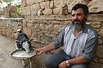 Lin-Pogradec-Albania - August 02, 2004---A man at/from the village of Lin feeding a goat; region/village of project implementation by GTZ-Wiram-Albania (German Technical Cooperation, Deutsche Gesellschaft fuer Technische Zusammenarbeit (GTZ) GmbH); people-portrait-agriculture---Photo: © HorstWagner.eu